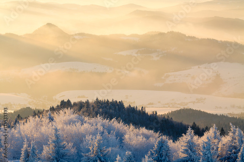 Mountain valley panorama during sunrise. Beautiful natural panoramic landscape in winter time.