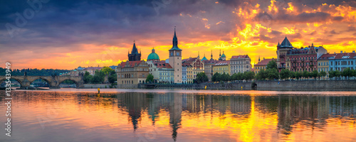 Photo sur Toile Prague Prague. Panoramic image of Prague riverside and Charles Bridge, with reflection of the city in Vltava River.
