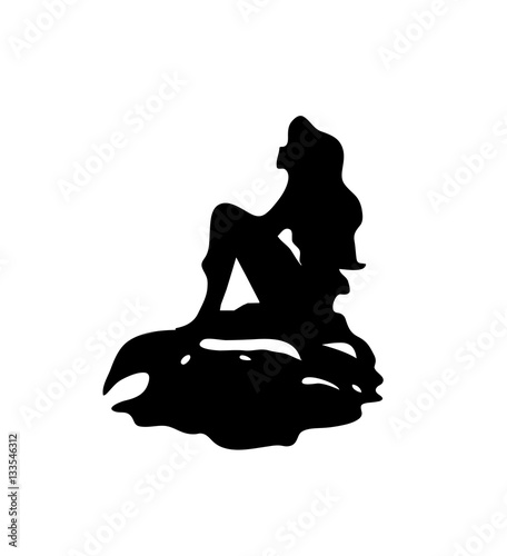 Photographie  Girl mermaid silhouette with a tail on a rock isolated.