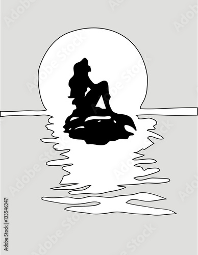Photographie  Girl mermaid silhouette with a tail on a rock in grey sea.