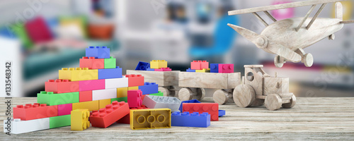 Fotografie, Obraz  Plastic building blocks,plane and blur background