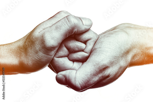 Male and female hand united in handshake. That could mean help, guardianship, protection, love, care etc. This Image isolated for easy transfer in your design.