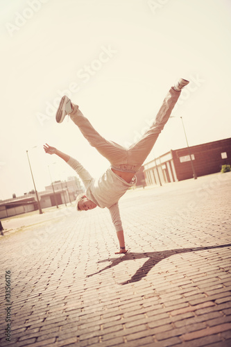 Fotografie, Obraz  Boy doing a handstand