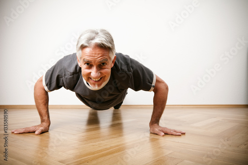 Man In His 50s Doing Pushups Canvas Print