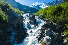 A Waterfall Fed By Glacial Meltwater Flowing Off The Glacier Du Bionnassay In The French Alps