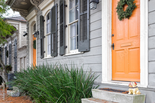 New Orleans Quaint Houses With Gingerbread Trim And Orange Doors