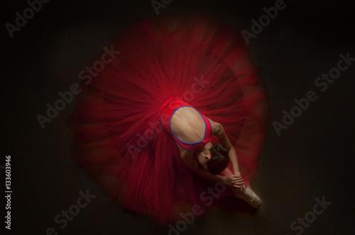 Fotografie, Obraz  beautiful ballerina woman laying on her knee with beautiful red tutu
