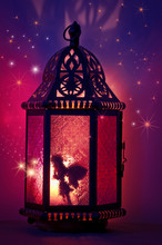 Fairy Inside Lantern With Sparkling Stars And Purple And Pink Colors/Fairy Inside Vintage Metal Lantern With Layers Of Stars And Purple And Magenta Colors In Background
