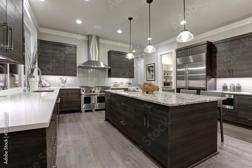 Modern gray kitchen features dark gray flat front cabinets paired ...