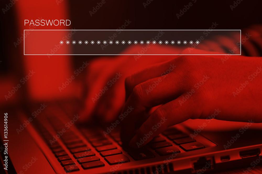 Fototapeta Typing online account password on laptop computer keyboard