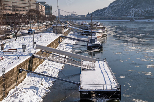 City on the water Embankment of Danube river at winter