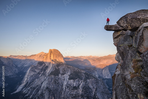 Hiker at Glacier Point at sunset, Yosemite National Park, California, USA