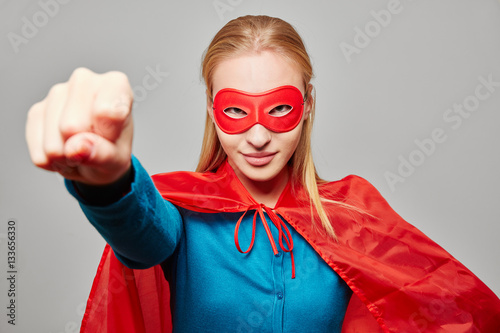 Photo  Woman dressed as a superhero with clenched fist