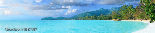 Photo Stands Tropical beach Beautiful tropical Thailand island panoramic with beach, white sea and coconut palms for holiday vacation background concept