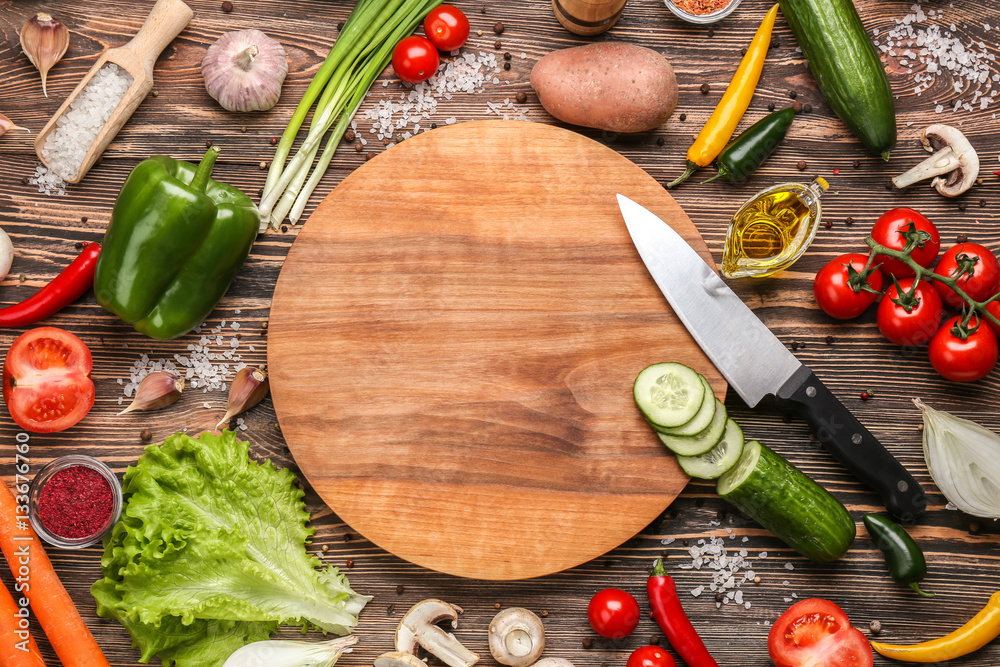 Fototapety, obrazy: Cutting board and vegetables on wooden background