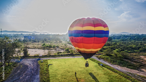 Tuinposter Ballon you can fly away in the sky with hot air balloon.Hot air balloons are something special in comparison to other forms of flight.As the balloon rises