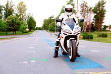 Biker Wearing Helmet On A Motorcycle Yamaha R1