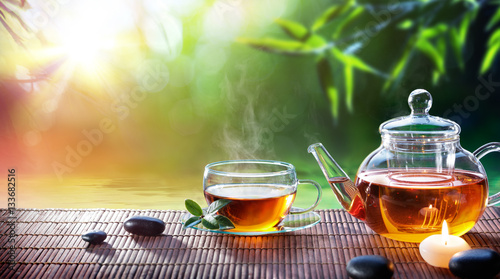 Tuinposter Thee Teatime - Relax With Hot Tea In Zen Garden