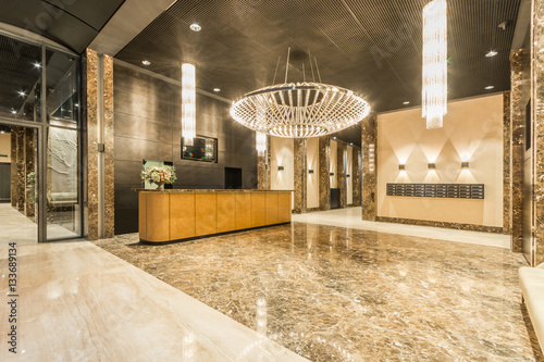 фотографія  Lobby entrance with reception desk in a business center building