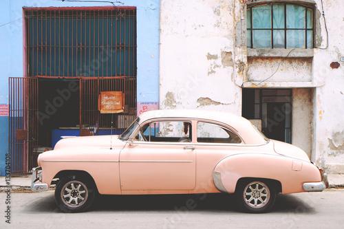 Vintage pink car on street