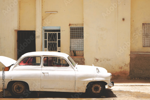 Vintage white car on street