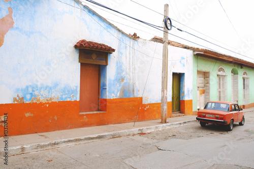 Foto op Plexiglas Retro Vintage orange colour car on street