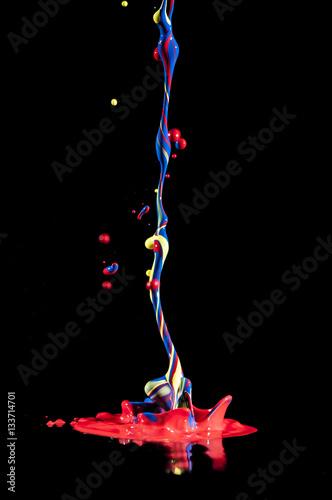 Tuinposter Vormen Colorful paint splashing indoors