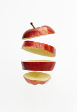 Fresh Red Golden Delicious Apple Cut Into Slices Floating