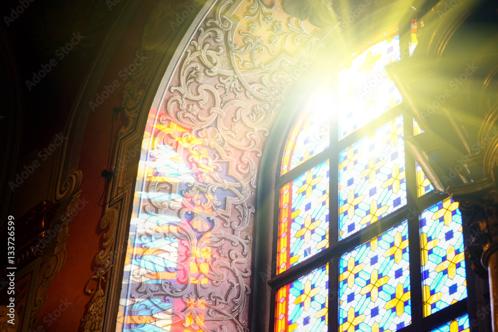 Fototapety, obrazy: The Bernardine church and monastery (church of St. Andrew) in Lviv, Ukraine. Church and fortification was built in 1600-1630. Beautiful stained glass window with sunlight. Religion and art concept.