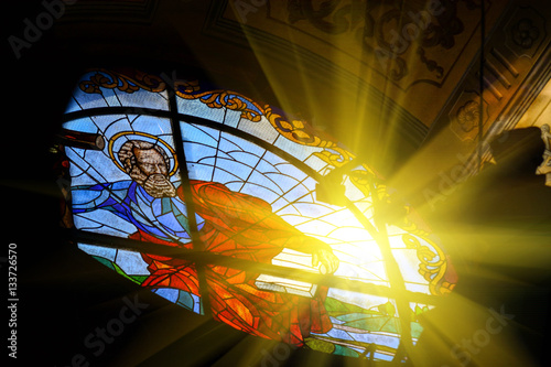 Photo sur Toile Edifice religieux The Bernardine church and monastery (church of St. Andrew) in Lviv, Ukraine. Church and fortification was built in 1600-1630. Beautiful stained glass window with sunlight. Religion and art concept.