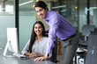Business Man and Woman Working Together in Office