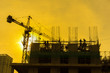 Silhouette of under construction building at twilight