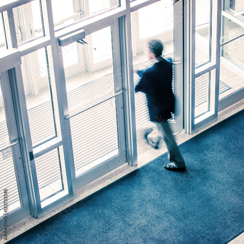 Man walking out of a business office Wall mural