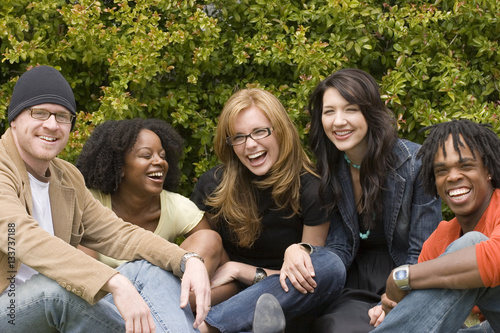 Diverse group of people talking and laughing.