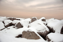 Snow Covered Rocks Along Shore...