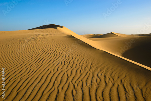 Foto  Sand dunes on the beach of Maspalomas, Gran Canaria, Spain