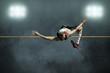 Leinwanddruck Bild - Athlete in action of high jump.