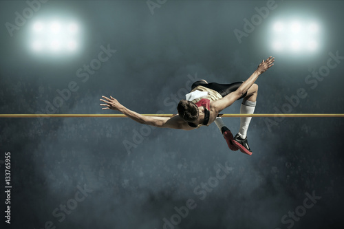 Fotografia, Obraz  Athlete in action of high jump.