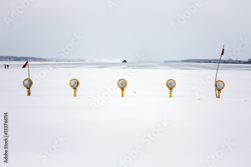 Approach lights of the winter airport runway - Buy this