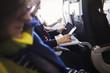 A passenger on an aircraft using a smart phone.