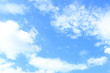 Clear white fluffy clouds in a blue sky. Sky background with blank space for text.