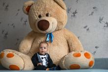 Little Boy And A Big Teddy Bear