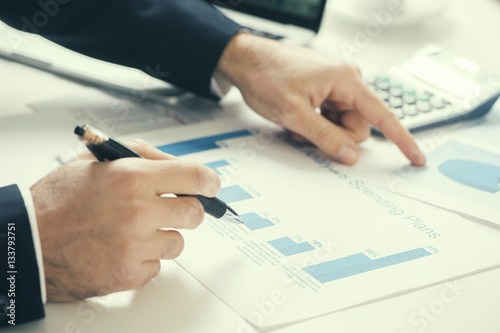 Photo Report. Business man in office with charts