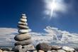 Zen stones on the beach with sun light