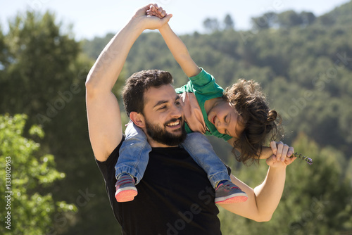 Fotografie, Obraz  Father and baby girl playing outdoors