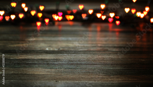 Fotografie, Obraz  Heart bokeh, Valentine's day concept on wooden background