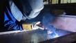 Welder working. Industrial video.