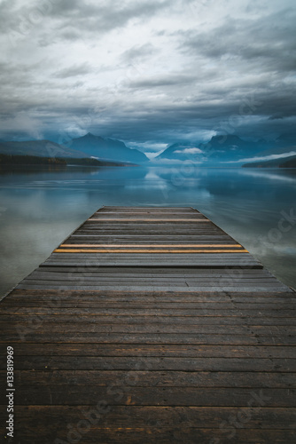 Lake dock overlooking a reflective lake.
