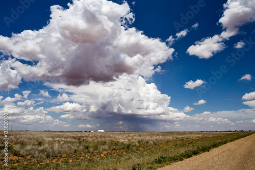 Poster Volcano Summer blue sky with white cumulus clouds