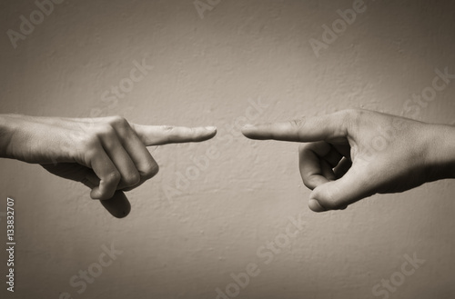 Fotografie, Tablou  Fingers pointing at each other